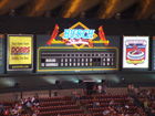 Upper deck manual scoreboard shows the Cardinals made it interesting in the 8th