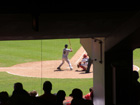 View of Moises Alou batting from ground level concourse