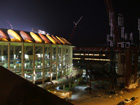 Busch Stadium at night next to new stadium progress