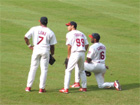 Hector Luna, So Taguchi, and Reggie Sanders chill in center field during a pitching change