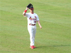 Jim Edmonds comes into the game for the 9th and salutes the fans in the bleachers