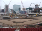 View of infield, outfield construction, the Arch, and the Old Courthouse from behind home plate