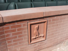 Cardinals logo on backstop wall