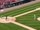 Chris Carpenter and Albert Pujols throw out the first pitches at Busch Stadium to Bob Gibson and Willie McGee