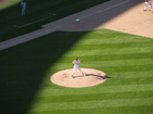Mulder pitches as the shadows creep onto the field