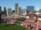 View of bleachers, scoreboard, and St. Louis skyline