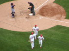 Rolen congratulates Pujols on his 2-run homer in the 2nd while David Eckstein looks like a batboy next to Rolen