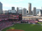 View of populated left field upper-deck and St. Louis Skyline