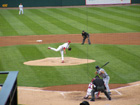 Chris Carpenter pitches to Grady Sizemore