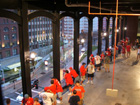 Fans stay dry on the Eads bridge replica