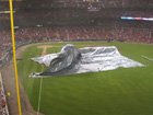A gust of wind inflates the rain tarp