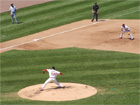 Jeff Suppan pitches while Scott Rolen stands ready at 3rd