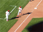 Oquendo congratulates So Taguchi on his leadoff HR in the 8th