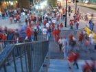 Cardinal fans cross the corner of 8th & Clark