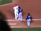 Albert Pujols and Carlos Beltran stand at first