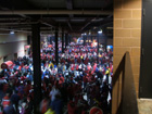 Cards fans try to stay warm and dry in the lower level concourse