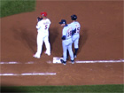 Andy Van Slyke stands at first base with Albert Pujols and Brandon Inge