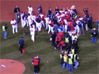 Cardinal players celebrate as media rushes in