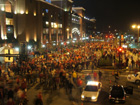 Fans celebrate in the street outside Busch Stadium