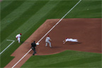 Aaron Miles slides head first into 3rd base