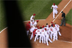 A mob awaits Matt Holliday at home plate