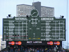 Center field clock and out of town scoreboard. Notice the pitchers duel between Houston and St. Louis.